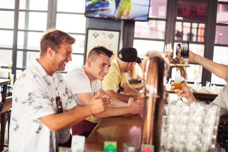 Men Drinking Beer on tap